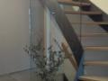 Stahlwangentr., Eiche geölt, ohne Geländer, mit Wandhandlauf und Glaswand